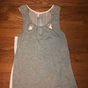 Grey and white flowy tank.